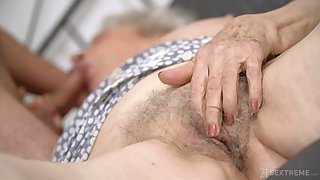 Infirm granny with chubby boobs Norma B gets intimate with young man