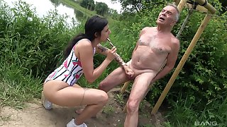 Provocative slut drops on her knees to suck an older man's learn of