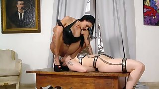 Dominant MILF acts rough exceeding slave girl's exposed pussy